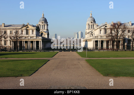 Symmetrical view of Royal Naval College from the Queens House, Greenwich, London, England, UK, with Canary Wharf - Stock Photo