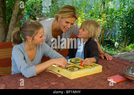 Family playing ludo - Stock Photo