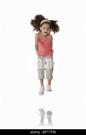 Young Girl on White Jumping - Stock Photo
