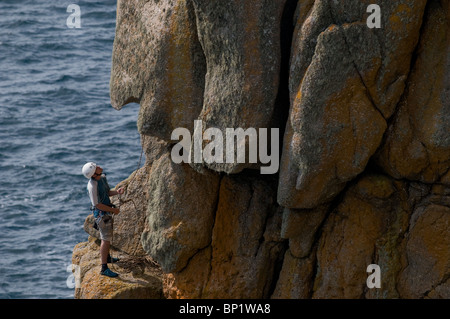 A climber on rocks at Gwennap Head in Cornwall. Photo by Gordon Scammell - Stock Photo