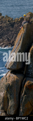 A climber on the rocky coast of Gwennap Head in Cornwall. Photo by Gordon Scammell - Stock Photo