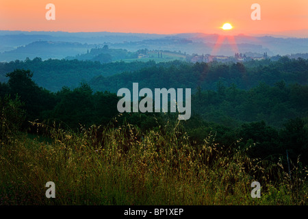 The hilly landscape surrounding the town of San Gimignano in Tuscany, Italy - Stock Photo
