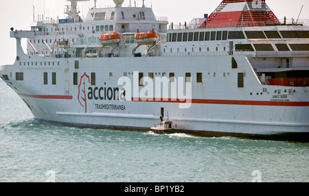 Pilot departing Passenger ferry as she sails from Malaga Spain - Stock Photo