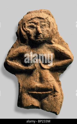 ASHERAH (ASHTORETH) - CNAANITE GODDESS OF FERTILITY, THE CONSORT OF THE PRINCIPAL GOD EL OR BIBLICAL BAAL.  THE CLAY FIGURINES D Stock Photo
