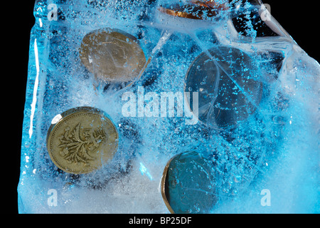 Currency Frozen in a block of Ice - Stock Photo