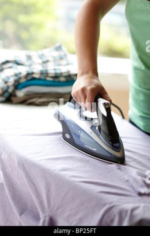 Woman ironing - Stock Photo