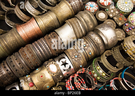 Bracelets are sold as souvenirs a market stall at Houmt Souk in Djerba, Tunisia. - Stock Photo