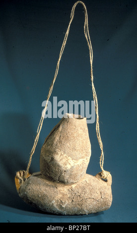 CLAY MADE CHURN FOR MAKING CHEESE OR BUTTER BY FILLING IT WITH MILK & SHAKING IT WHILE IT IS HANGING BY THE ROPE. - Stock Photo