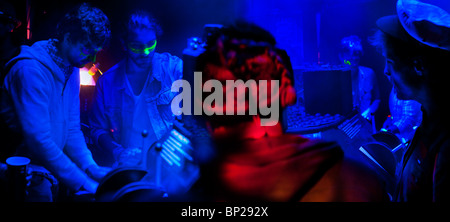 Glastonbury Festival, 2010, people on computers mixing music - Stock Photo