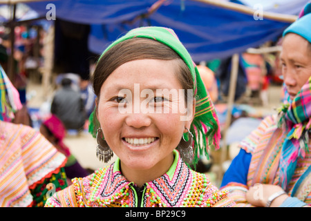 A Flower hmong girl poses for a photo at the Sunday market in Bac ha, Vietnam - Stock Photo