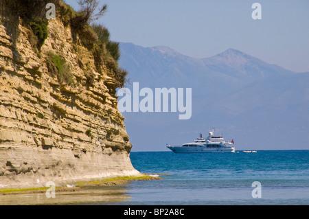 Luxury yacht passing Sidari on the Greek island of Corfu Greece GR - Stock Photo