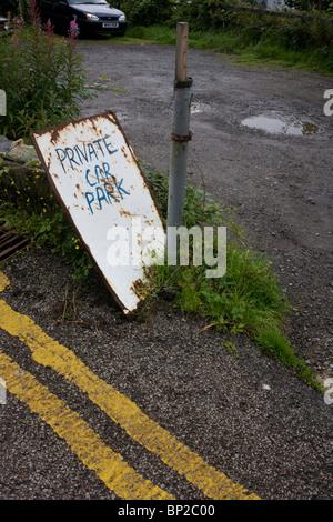 Makeshift private car park in Oban, Scotland. - Stock Photo