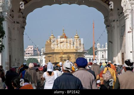 Sikh pilgrims visiting the Golden Temple. Amritsar. Punjab - Stock Photo