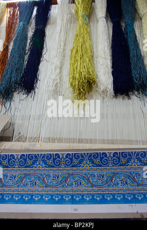 Carpet weaving in Diyarbakir, Eastern Turkey - Stock Photo