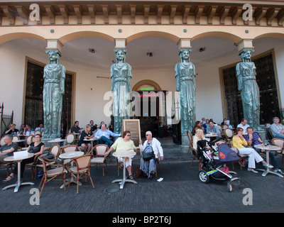 Busy outdoor summer cafes in central Utrecht in the Netherlands - Stock Photo