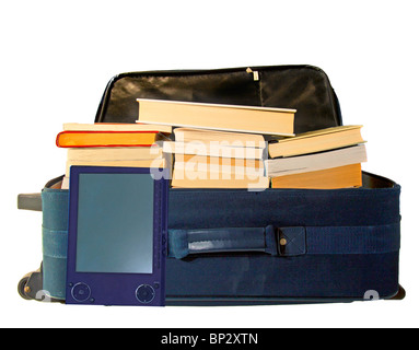 A blue suitcase for travel completely full of books next to an ebook reader (Sony prs505) - Stock Photo