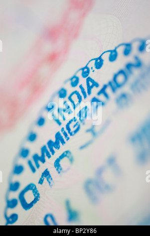 India immigration stamp in a British passport. Selective focus - Stock Photo