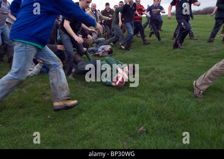 Traditional game of Bottlekicking, Leicestershire, UK - Stock Photo