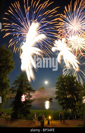 Midsummer night. Fireworks and moon over the lake, BUGA Park, Bundesgartenschau Park, Britzer Garten,  Britz, Neukoelln, - Stock Photo