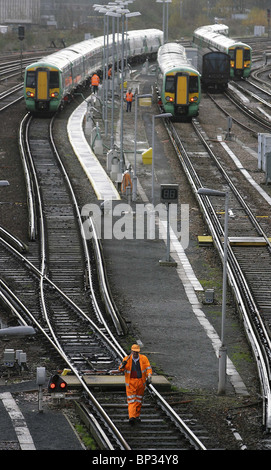 A worker is seen at a Network Rail maintenance depot outside Brighton station. Picture by James Boardman. - Stock Photo