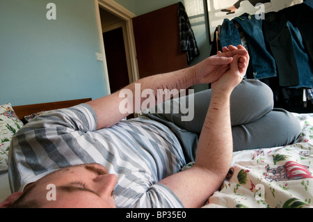 Extremely depressed young man self harming and suicidal. - Stock Photo