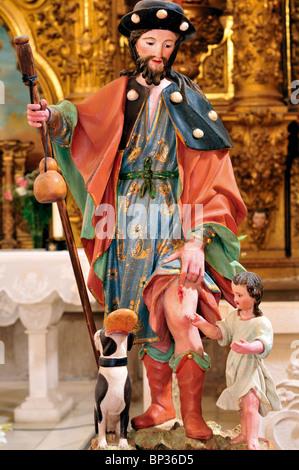 Spain, St. James Way: Statue of San Roque in the parish church Iglesia Nuestra Senora de la Asuncion in Redecilla - Stock Photo