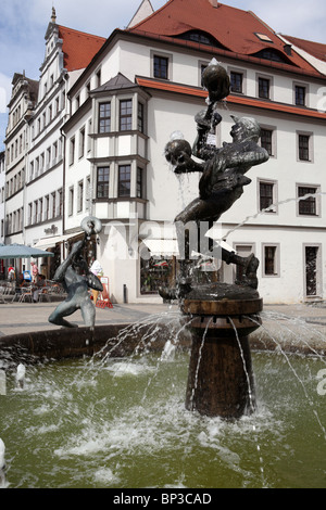 Fountain sculpture, 'Fools and Musicians', by Erika Harborth, in the market square of Torgau, a German town on the - Stock Photo