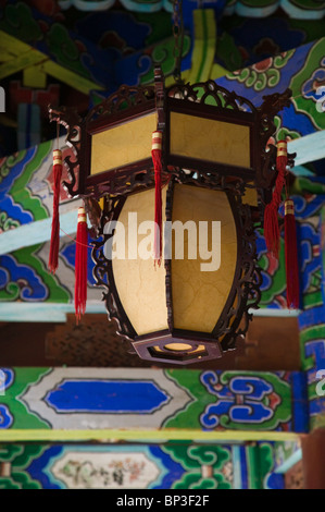 CHINA, Yunnan Province, Lijiang. Lijiang Old Town, Temple Lamp at the Mu Family Mansion. - Stock Photo