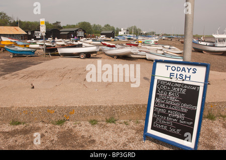 A sign advertising todays fresh line caught fish for sale at Orford , Suffolk , England , Great Britain , Uk - Stock Photo