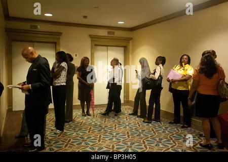 Job seekers at a job fair in midtown in New York - Stock Photo