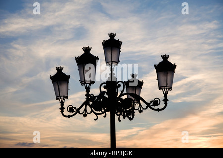 Medina Sidonia, Andalusia, Spain; A Light Post With 5 Lamps On It - Stock Photo