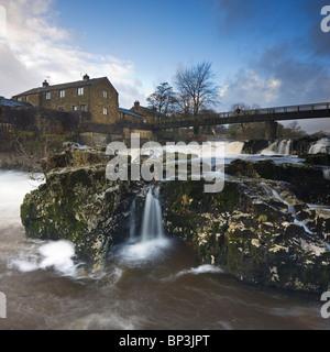 River Wharfe flowing over Linton Falls near Grassington Wharfedale Yorkshire Dales UK square tilt shift panoramic - Stock Photo
