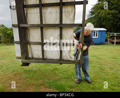 Man maintaining the Nutley post Windmill. - Stock Photo