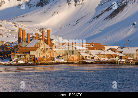 UK Territory, South Georgia Island, Leith Harbour. Sunrise on abandoned whaling station factory. - Stock Photo