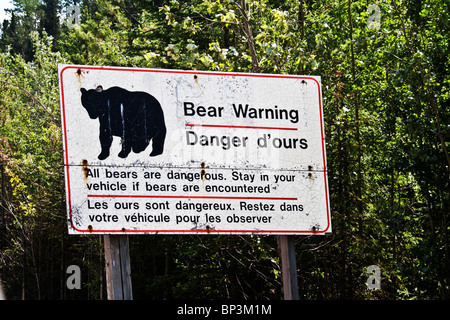 Sign warning visitors about bear, Jasper National Park, Canada - Stock Photo