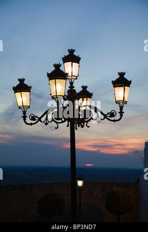 Medina Sidonia, Andalusia, Spain; A Light Post With 5 Lamps On It Illuminated At Night - Stock Photo