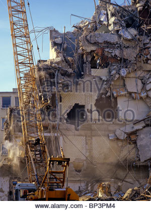 demolition of building by wrecking ball stock photo