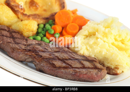 A traditional pub-grub style British meal of rump steak, mixed veg, mashed and roasted potatoes and - Stock Photo