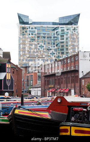 The Cube building towers over Gas Street canal basin in Birmingham, UK - Stock Photo