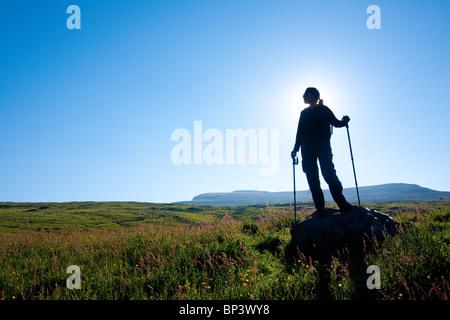 Hiker on the island Runde in Herøy kommune on the Atlantic west coast, Møre og Romsdal fylke, west coast of Norway. - Stock Photo
