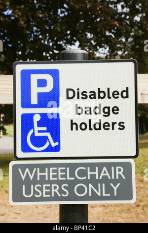 England, UK, Britain. Car park sign for disabled parking bay blue badge holders for wheelchair users only. - Stock Photo