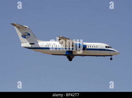 Romavia British Aerospace 146-200 small airliner on approach. Side view. - Stock Photo