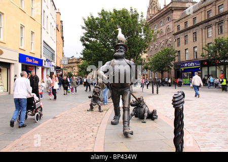 Statues of Desperate Dan, dog and Minnie the Minx in the pedestrian area of Dundee. - Stock Photo