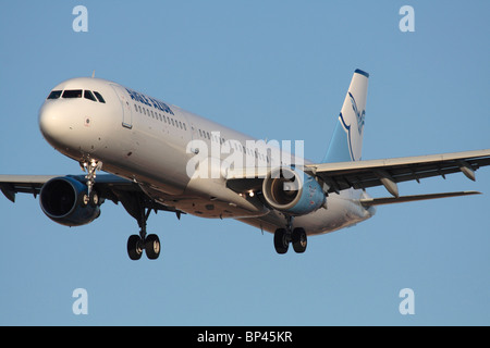 Aigle Azur Airbus A321 passenger jet plane on approach. Closeup front view. - Stock Photo
