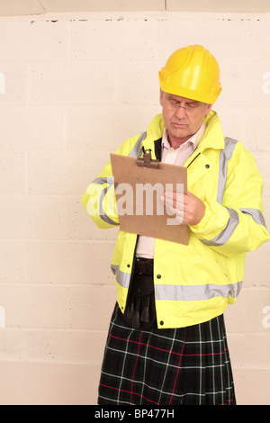 Scott's construction inspector, in hard hat and kilt - Stock Photo