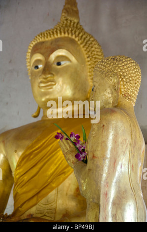 Thailand, Island of Ko Samui (aka Koh Samui). Golden Buddha statue at Khunaram Temple. - Stock Photo