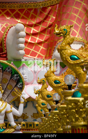 Thailand, Ko Samui . Wat Plai Laem aka Plai Laem Temple, Golden rooster statues in front of Happy Buddha of Prosperity - Stock Photo