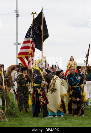 Native Americans at the Healing Horse Spirit PowWow in Mt. Airy, Maryland carry an American flag POW-MIA flag. - Stock Photo