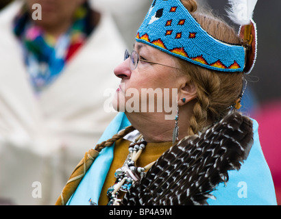 A Native American dresses in full traditional regalia at the Healing Horse Spirit PowWow in Mt. Airy, Maryland. - Stock Photo
