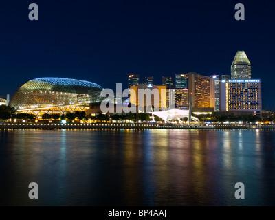 The night Esplanade skyline in Singapore, as seen from across Marina Bay. - Stock Photo